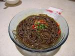 Followed by a cold dish such as these 冷面 [Lěng miàn](cold noodles)